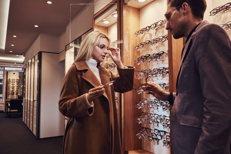 Woman is choosing new frames for glasses